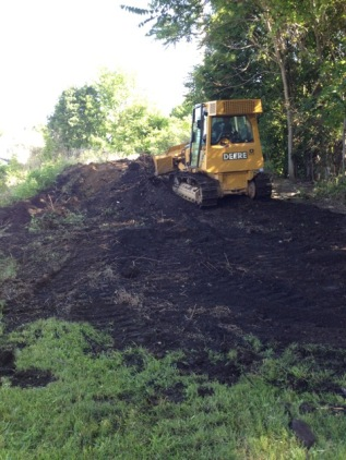 Attacking the hill! Good News--it is all soil and no construction debris!!!